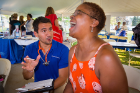 Yvette Gaines-Hicks (right) participates in a heath screening guided by nurrsing student Chris Streb (left) while at UB on the Green on July 19, 2017.