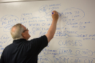 A member of the Emergency Response Center team uses a white board