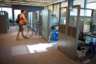Cory Nealon places his bicycle in its storage spot in 330 Crofts Hall.