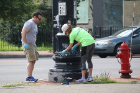 Robert Mayer Jr., UB Director of Government Relations and Tess Morrissey, UB Director of Community Relations joined volunteers giving light posts along Main Street in University Heights a new coat of paint.