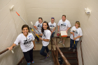 Phyllis Floro, Susan Orouurke, Britani Pruner, Sarah Nordland, Jude Butch and Amy Boies-Riek paint the hallway at the City Mission.
