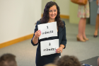 Hadar Borden, program director for the Blackstone LaunchPad at UB, holds cards that will let the pitch participants know how much time they have left for their presentation. Blackstone LaunchPad is a partner in the Social Impact Fellows Program along with the School of Management and the School of Social Work.