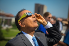 President Satish K. Tripathi watching eclipse with glasses.