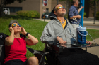 Sue Nuemeister and Tim McCarthy observe the eclipse from the ground