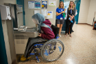 Testing a wheelchair-accessible drinking fountain in Kimball Hall. Photo: Meredith Forrest Kulwicki