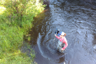 Kristin Thomas, aquatic ecologist for Michigan Trout Unlimited, an organization that has been supportive of the new project, measures stream discharge along the lower section of the Boyne River. Photo: Damon Hall