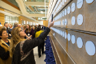 Donors took the opportunity to photograph their names on the wall honoring the Circle of Leaders, which includes 207 members.