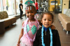 Anari Stokes (pink princess) and Javion Osorto (in blue lei), ages 4 and 3.