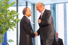 At the opening ceremony, President Tripathi and Jeremy M. Jacobs share a heartfelt handshake.