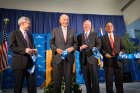 "UB Provost Charles Zukoski, Jeremy Jacobs, Michael Cain and Satish Tripathi, each with ""pieces of UB"" from the ceremonial ribbon-cutting."