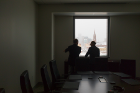 Awe-inspiring inside and out: in silhouette, attendees admire the dramatic views of downtown Buffalo.