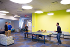Students play some ping pong in a student lounge.