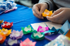 Students make some origami roses as part of Love and Support Day.