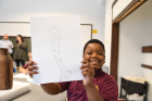 Davion Williams, age 9, shows off his drawing.