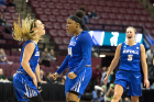 Buffalo guard Cierra Dillard, center, celebrates making a three point shot with Buffalo guard Stephanie Reid, left, as Buffalo guard Katherine Ups (5) joins in during the 1st half of their game against South Florida in round one of the NCAA basketball tournament in Tallahassee, FL March 17, 2018.