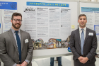 Eamon Riley (left) and David Yovanoff, both law students, pose in front of their reseach poster.