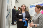 Ashley Cohen (left), sociology major, discusses her research with Ann Bisantz, Dean of Undergraduate Education, Professor of Industrial and Systems Engineering.