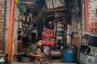 A boy working inside an e-waste recycling shop. Child labor is very prevalent in this industry, Aich says.