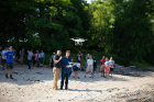 Piloting a drone as it takes off from the beach are Le Wang (left) and Nathan Dubinin, a research assistant for the Geo-Technology Experiences for Students and Teachers (GTEST) project.