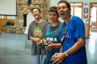 John Cerne (right) and campers fly the radio-controlled plane in the Jim Kelly House.