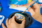 Participants painting rocks were encouraged to share their artwork on Facebook.