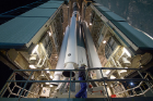 Workers prepare the Delta II rocket for launch. The rocket carries the ICESat-2 satellite on board. Photo: NASA/Bill Ingalls