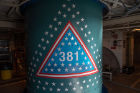 An emblem signifies the 381st flight of the United Launch Alliance Delta family on the Delta II rocket with NASA's ICESat-2 on board. The first Delta I was launched in May 1960. A star traditionally was placed on the rocket to recognize each mission. The final Delta II boasts more than 150 stars with over 800 signatures of people who have been part of the Delta II program. Photo Credit: (NASA/Bill Ingalls)