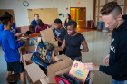 Buffalo area students peruse the supplies collected.