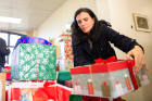 Sara Zeitler, vice dean for records, registration and financial aid in the School of Law, sets up the gifts donated by faculty and staff at the law school.