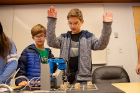 Brothers Lucas (left) and Henry Strong play some robot tic-tac-toe and appear to be enjoying some success.