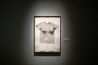 The exhibit also features a series of monoprints of T-shirts worn by volunteers as they performed physical activity. The shirts were infused with a dark substance to highlight perspiration and then put on a press to make a print.