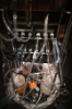The 80-gallon fermenters are cradled by temperature-regulating units and motorized mixers connected by hoses to gas, nutrient and waste canisters.