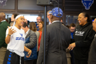 Women's basketball player Cierra Dillard (left) chats with Buffalo Mayor Byron Brown (center in blue cap) and coach Felisha Legette-Jack. Also pictured are President Satish K. Tripathi (far right) and A. Scott Weber, vice president for student life (behind Brown). Photo: Meredith Forrest Kulwicki