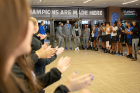 Members of the university community cheer some players from the men's basketball team as they walk through the lobby of Alumni Arena. Photo: Meredith Forrest Kulwicki