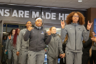 "Some members of the women's basketball team give the ""horns up"" sign as they walk out of Alumni Arena. Photo: Meredith Forrest Kulwicki"