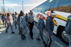Members of the women's basketball team board their bus to begin their journey to Connecticut for the NCAA Tournament. Photo: Paul Hokanson
