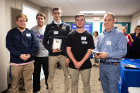 "The second-place team, ""M.A.I.L. Men,"" from Amherst Central: (from left) Ian Nettleton, Max Rosen, Aden Clemente and Ian Leising, along with UB biostatistics professor Dietrich Kuhlmann. Photo: Douglas Levere"