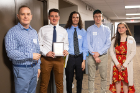 UB biostatistics professor Dietrich Kuhlmann poses with the third-place team from Grand Island: (from left) William Soos, Christian Whetham, Brady Hofmeyer and Kassidy Taylor. Photo: Douglas Levere
