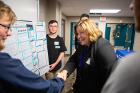 Jean Wactawski-Wende, dean of the School of Public Health and Health Professions, shakes hands with participants in the inaugural statistics competition. Photo: Douglas Levere