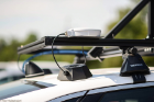 A close-up look at the GPS antenna — the light-colored box sitting on top of the roof rack — which connects to a cable box below.