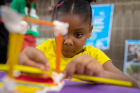 Five-year-old Tyanna works on her playhouse with a slide and a boat during the Imagine LaSalle public workshop Sept. 11 at Waterfront Elementary BPS #95.