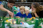 Teresa Bosch, an associate planner in the UB Regional Institute, brought her sons, Mateo (right), 4, and Lucas, 5, to the workshop. They are speaking with Andy Wisniewski, senior associate with Michael Van Valkenburgh Associates, the firm leading the conceptual design of the park.