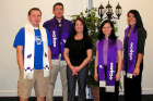 2009 graduating Native students wear custom-made stoles that symbolize the Haudenosaunee nations and clans. The students, from left: Aaron VanEvery, Ross John Jr, Jamie Marr, and Ashley Schultz.