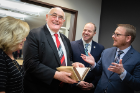Irish Sen. Billy Lawless examines another book in the Joyce Collection.