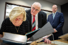 Billy Lawless looks over the shoulder of his wife, Kate, as she pores over a book from the Joyce Collection. In the background is state Sen. Tim Kennedy, who accompanied the Lawlesses on their tour.
