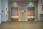 Elevators clearly indicate capacity and where to stand to ensure proper physical distancing practices. Photo: Douglas Levere