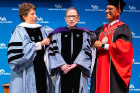 Justice Ruth Bader Ginsburg is flanked by President Satish K. Tripathi and Merryl H. Tisch, chairman of the SUNY Board of Trustees. Photo: Douglas Levere