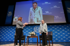Justice Ruth Bader Ginsburg is greeted with applause as she sits down for a Q&A with School of Law Dean Aviva Abramovsky (left). Photo: Nancy J. Parisi