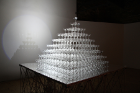 """Tide"" is a pyramid of champagne glasses that gradually fill with water over the course of the exhibition, fed by a slow-dripping tube attached high above the uppermost glass."