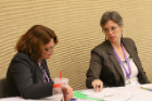 "Jennifer A. Livingston, PhD, and Kathleen E. Miller, PhD, of RIA discuss a question made of the panel during the ""Bullying and Substance Use Among Adolescents"" workshop"